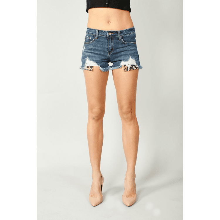 MID RISE DISTRESSED DARK WASH SHORT